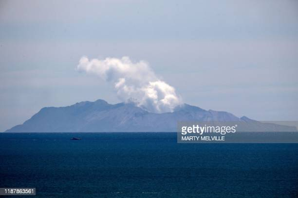 TOPSHOT Steam rises from the White Island volcano following the December 9 volcanic eruption in Whakatane on December 11 2019 The smouldering New...