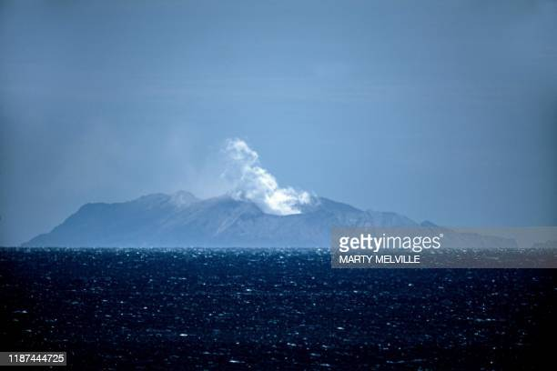 TOPSHOT Steam rises from the White Island volcano in Whakatane on December 10 after a volcanic eruption the day before New Zealand's Prime Minister...