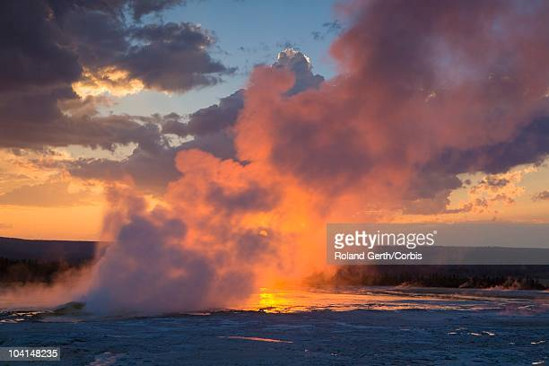 Steam rises in the Lower Geyser Basin at sunset