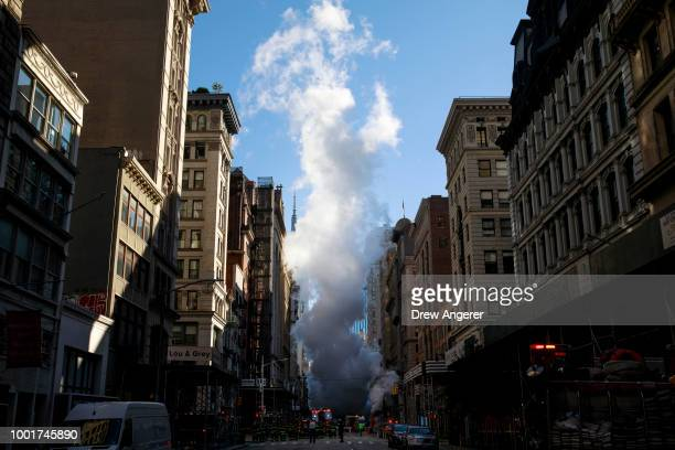 Steam rises near the site of a steam pipe explosion on Fifth Avenue near the Flatiron District on July 19 2018 in New York City Buildings were...