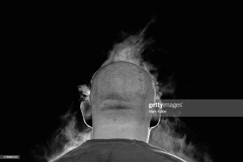 Steam rises off David Klemmer of the Bulldogs as he watches on from the bench during the round 16 NRL match between the Canterbury Bulldogs and the Melbourne Storm at Belmore Sports Ground on June 29, 2015 in Sydney, Australia.