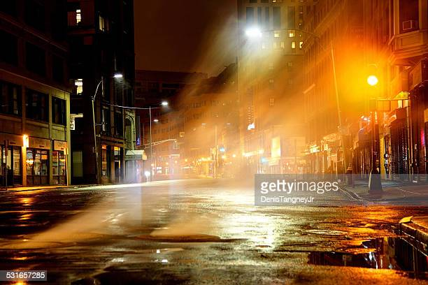 Steam rising from manhole cover on city street