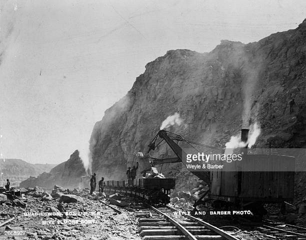 A steam shovel working in Fish Cut Green River Wyoming during contruction work on the Union Pacific Railroad