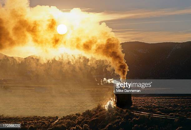 steam, smoke, sunset - steam train stock pictures, royalty-free photos & images