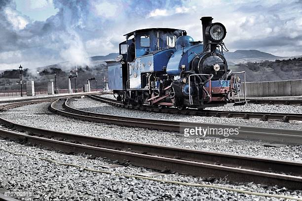 Steam Train Against Clouds