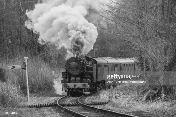 steam train approaching - locomotive stock pictures, royalty-free photos & images
