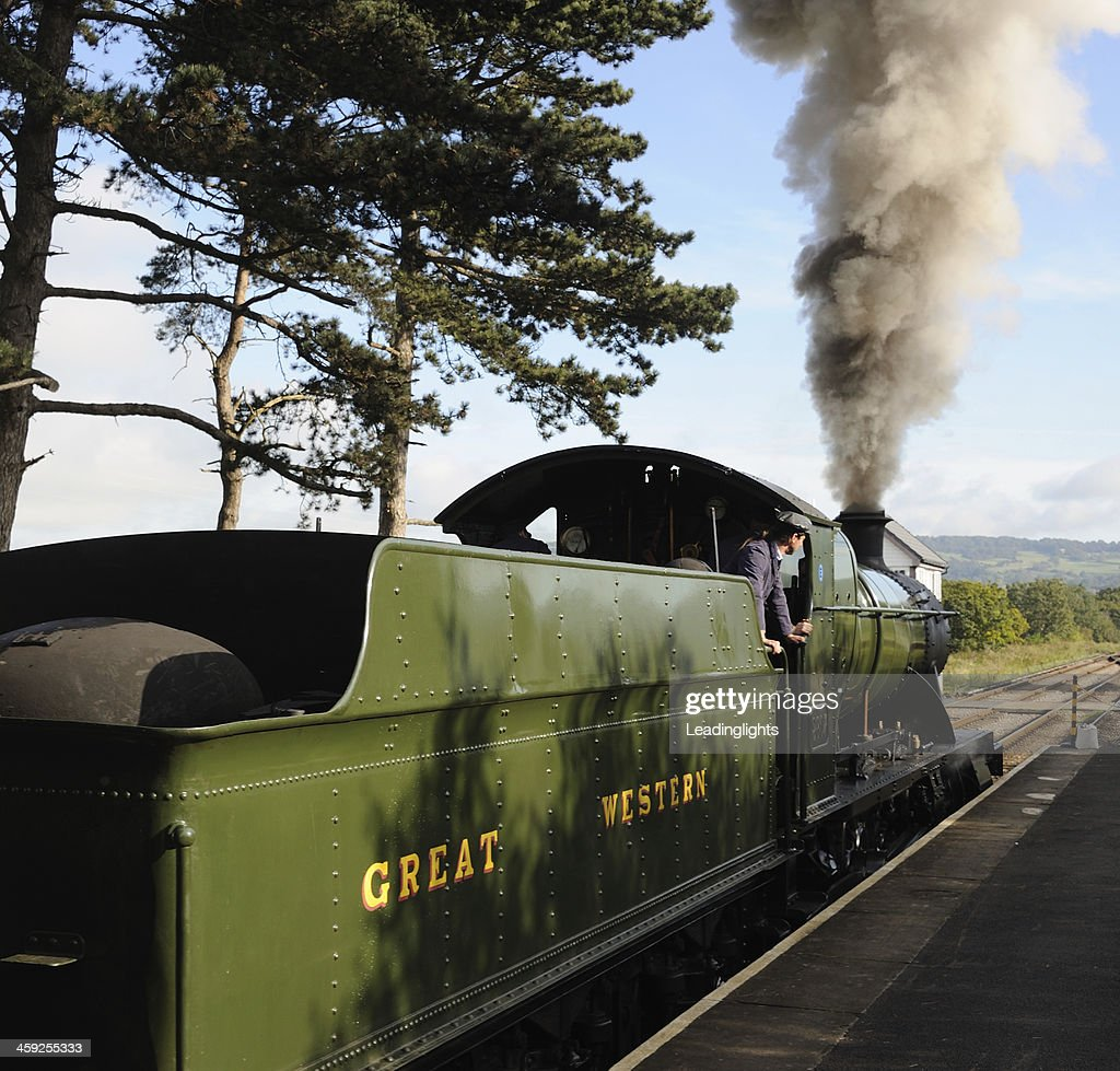 Steam Train Departing : Stock Photo