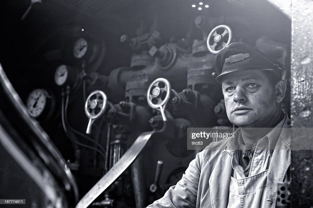 Steam train driver aboard footplate of Princess Elizabeth : Stock Photo