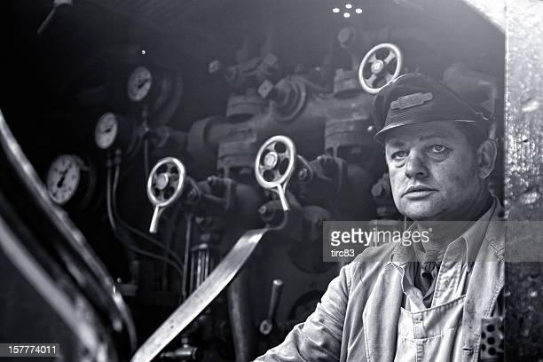 Steam train driver aboard footplate of Princess Elizabeth