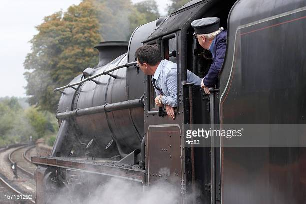 steam train drivers - locomotive stock photos and pictures