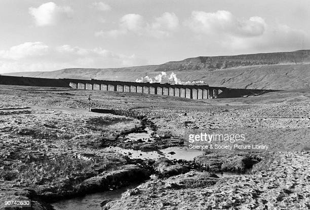 Steam train heading north across the Ribblehead Viaduct on the Settle to Carlisle line Photograph by Bishop Eric Treacy Treacy was often allowed...