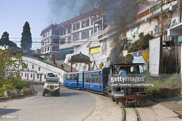 Steam train known as the Toy Train passing in front of Druk Sangak Choling Gompa (Dali Monastery), Darjeeling Himalayan Railway, UNESCO World Heritage Site, Darjeeling, West Bengal, India, Asia