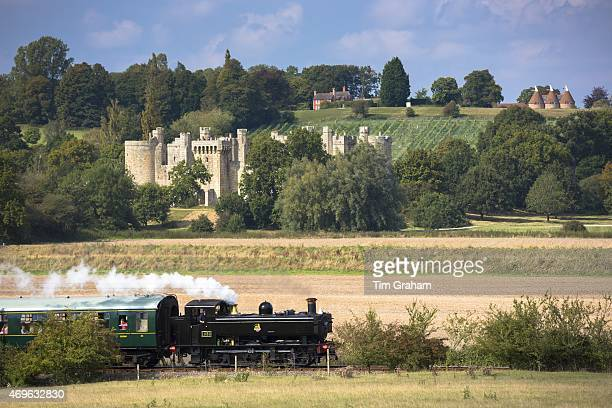 Steam train locomotive engine of Kent and East Sussex Railway and Bodiam Castle National Trust tourist attraction England UK