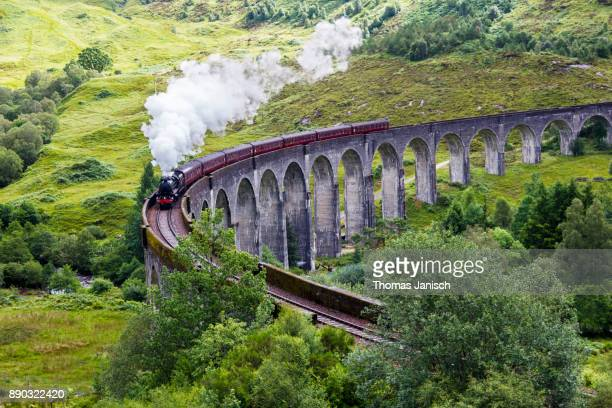 steam train on glenfinnan viaduct, scotland - scotland stock pictures, royalty-free photos & images