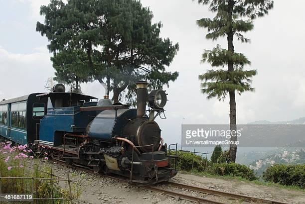 Steam train on railroad tracks Darjeeling Himalayan Railway Darjeeling West Bengal India