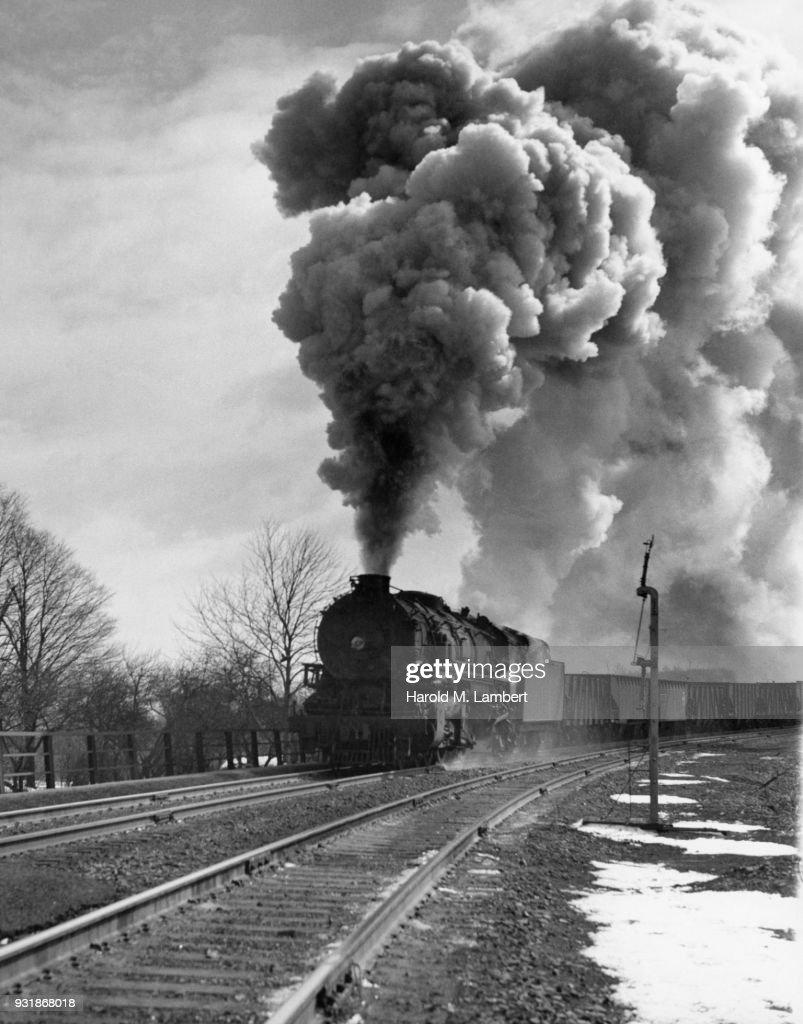 Steam train on railway track : Stock Photo