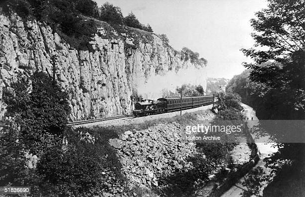 A steam train passes along the Buxton branch of the Midland Railway in Derbyshire circa 1910