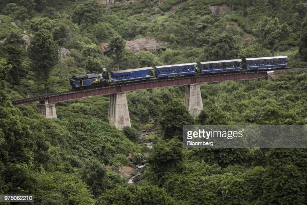A steam train travels along a viaduct through a tea estate in Coonoor Tamil Nadu India on Friday June 8 2018 Even though India is the world's biggest...