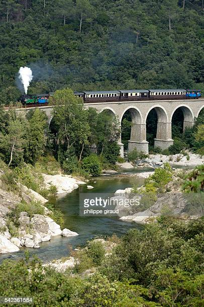 A steam train travels between Anduze and St Jean du Gard in the Cevennes region along the viaduc which stretches over the two Gardons Gardon du...