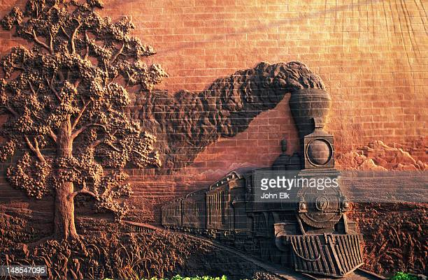 steam train wall sculpture, iron horse legacy, iron horse park, haymarket district. - lincoln nebraska stock pictures, royalty-free photos & images