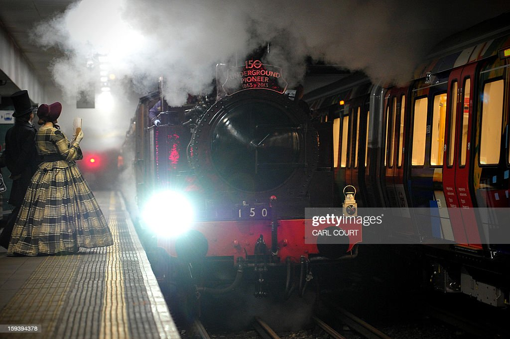 A steam train which carried passengers in the 19th century arrives in Moorgate Underground Station in central London on January 13, 2013, to mark 150 years since the first London underground journey.