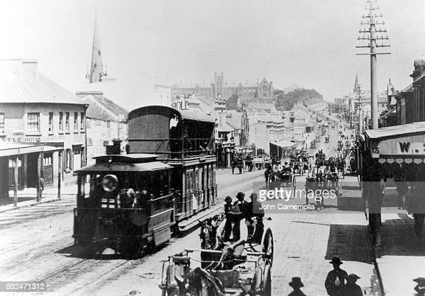 Steam tram and horse drawn wagons on George Street west with Sydney University at the top of the hill in 1880 Sydney Australia