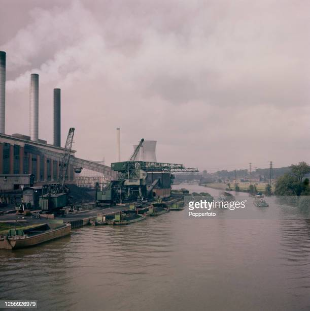 A steam tug hauls a line of tom pudding tub boats loaded with coal to Ferrybridge A power station located on the Aire and Calder Navigation near...