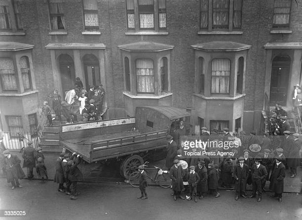 A steam wagon accident in Chelsea London A wagon which is across the pavement has drawn a small crowd and is being guarded by a policeman