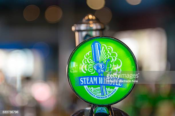 Steam Whistle beer tap handle green design with company's logo The company produces a premium pilsner lager packaged in distinctive green glass...