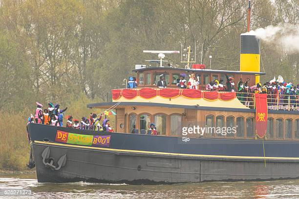 steamboat of sinterklaas arriving in the netherlands - vintage steamship stock photos and pictures