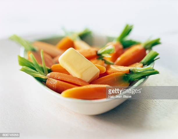 Steam-cooked carrots with a nut of butter