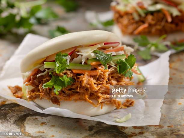 steamed bao buns with pulled pork - bun stock pictures, royalty-free photos & images