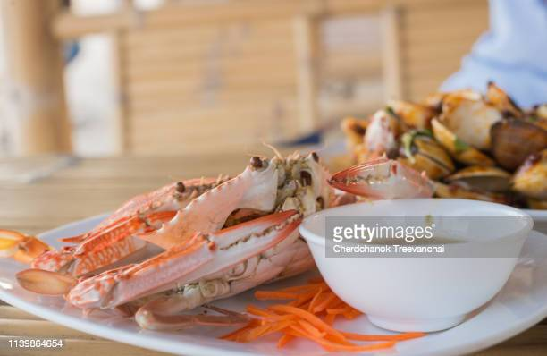 steamed blue swimming crab with chilli paste, seafood - chilli crab stock photos and pictures