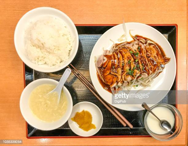 steamed chicken with chili sauce, lunch meal served on table - takuan stock photos and pictures