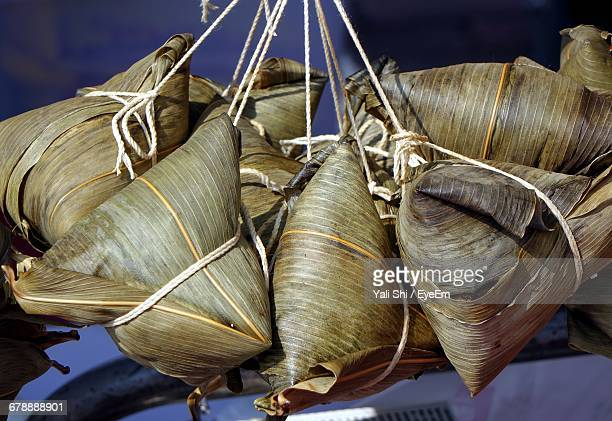 Steamed Chinese Sticky Rice Dumplings Wrapped In Bamboo Leaves