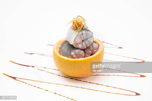 steamed eel in grapefruit - saltwater eel stock photos and pictures