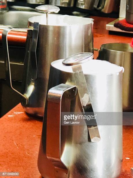 Steamed milk in steel containers for cafe latte
