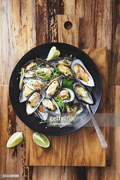 Steamed mussels with herbs in coconut sauce