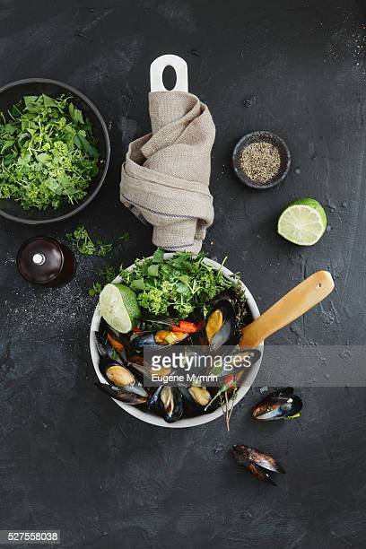 Steamed mussels with herbs in wine sauce
