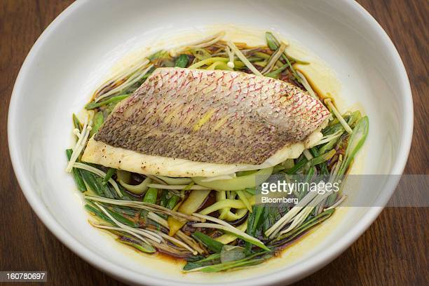 $36 steamed red snapper is served at Arlington Club in New York US on Monday Jan 28 2013 The cold fish is perfumed with the pungent flavor of...