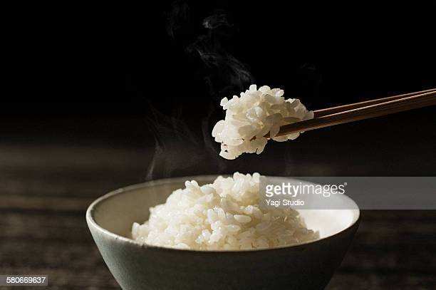 Steamed Rice Served In Bowl on wood