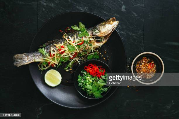 steamed sea bass - perch fish stock pictures, royalty-free photos & images