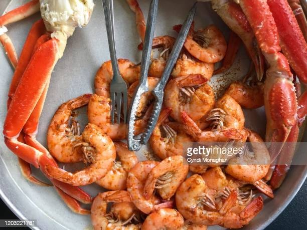 steamed shrimp and crab legs - gulf coast states stock pictures, royalty-free photos & images