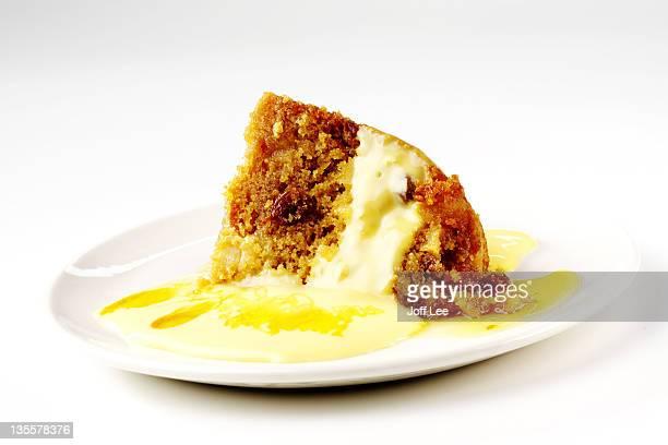 Steamed treacle & raisin sponge pudding with custard