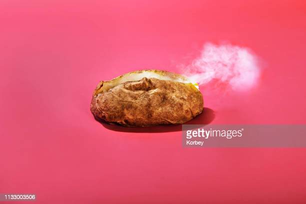 steaming baked potato - prepared potato stock pictures, royalty-free photos & images