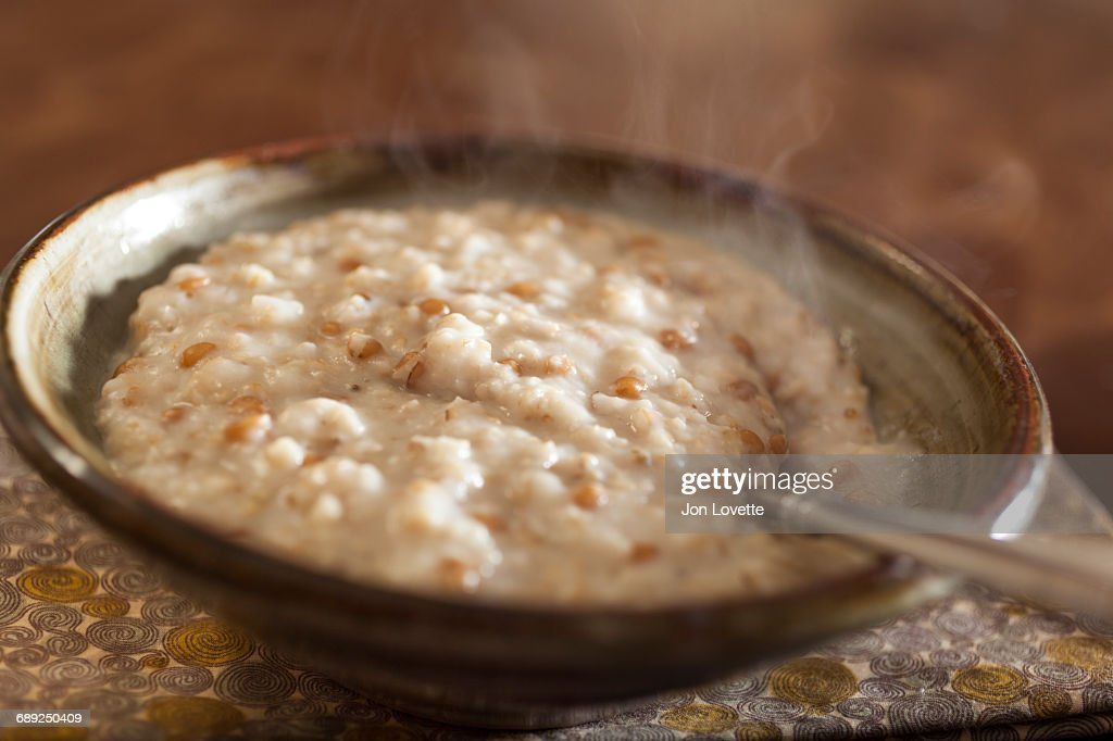 Steaming bowl of oatmeal porridge : Stock Photo