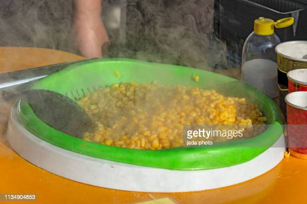 steaming cooked corn maze