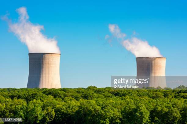 steaming cooling towers at nuclear power plant - moselle france stock pictures, royalty-free photos & images