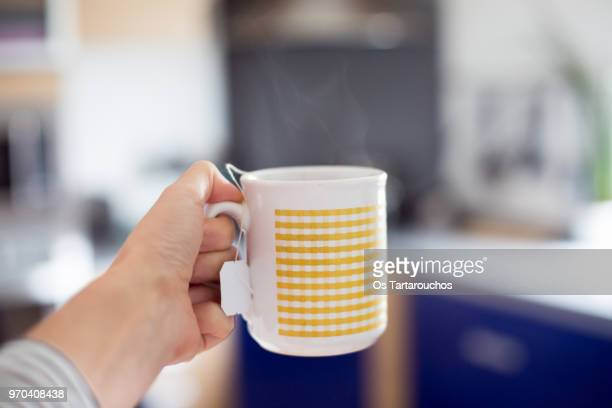 steaming cup of tea with kitchen background - hot spanish women stock pictures, royalty-free photos & images