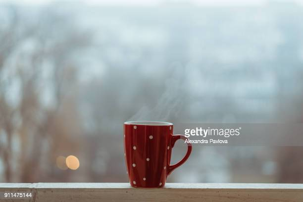 steaming cup (of coffee) on a foggy morning - mug stock pictures, royalty-free photos & images